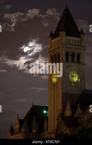 A perigee full moon or supermoon is seen over the Old Post Office and Clock Tower, Sunday, August 10, 2014, in Washington. - Stock Photo