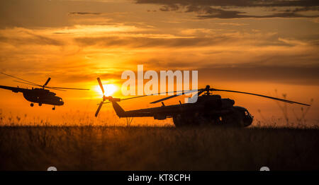 A Russian Search and Rescue  helicopter departs the Soyuz TMA-15M spacecraft landing site after the capsule landed - Stock Photo