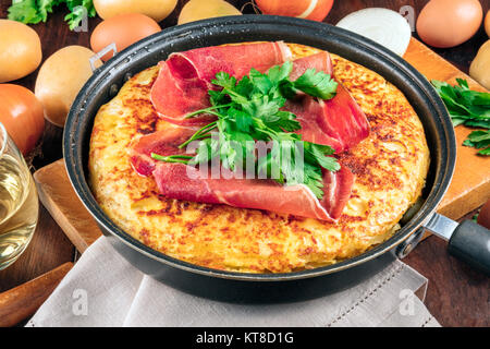 A closeup photo of a Spanish tortilla with ingredients - Stock Photo