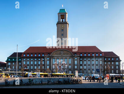 Berlin Spandau Town hall. Ferris wheel of German Christmas market stalls in front of the city hall. The Rathaus - Stock Photo