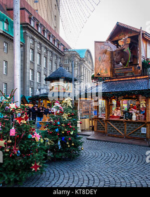 People Visit Stalls At Traditional German Christmas Market Outside