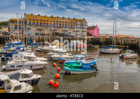A colourful collection of fishing boats and pleasure craft in the harbour at West Bay on the Jurassic Coast in Dorset, - Stock Photo