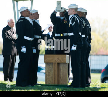 Sailors participate in the graveside service for U.S. Navy Petty Officer 3rd Class Charles Thomas Dougherty in Arlington - Stock Photo