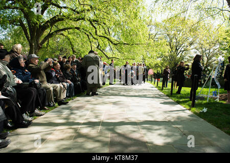 Participants in the annual ceremony wait to lay wreaths by The Spirit of the Elbe marker in Section 7A of Arlington - Stock Photo