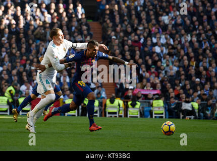 Madrid, Spain. 23rd Dec, 2017. Barcelona's Paulinho (R) and Real Madrid's Sergio Ramos vie for the ball during the - Stock Photo