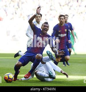 Madrid, Spain. 23rd Dec, 2017. Barcelona midfielder PAULINHO is fouled by Real Madrid midfielder CASEMIRO during - Stock Photo