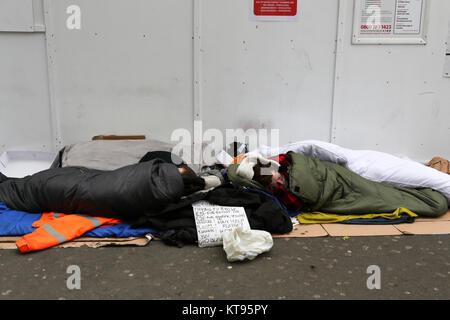 London, UK. 23rd Dec, 2017. Two homeless men outside Tottenham Court Road tube station. Credit: Penelope Barritt/Alamy - Stock Photo
