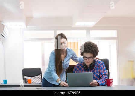 Portrait of startup group of creative people having a meeting with a laptop in a modern office. Business people - Stock Photo
