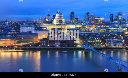 Panoramic view of St Paul's Cathedral and the City of London skyline illuminated at night, London, UK - Stock Photo
