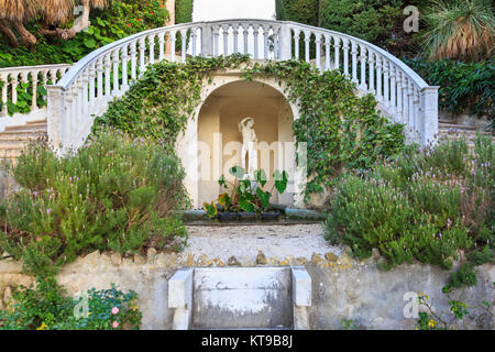 Statue and stairs in the Florentine garden at Villa Ephrussi de Rothschild, also called villa Île-de-France, Saint - Stock Photo