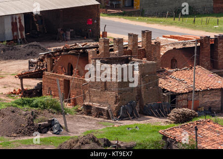 Roofing tile and bricks traditional operations factories and wood fired kilns, Tobati District, Cordillera Department, - Stock Photo