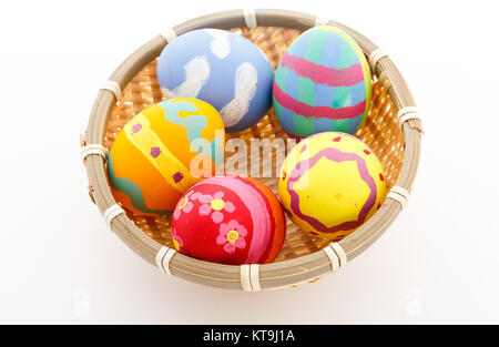 Colorful handmade easter eggs in a basket - Stock Photo