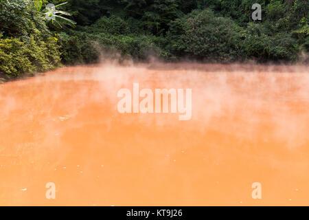Red pond in Umi Jigoku at Beppu city - Stock Photo
