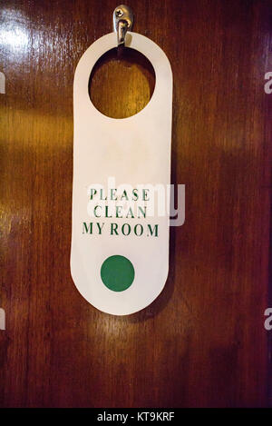 Clean room sign on doorknob - Stock Photo