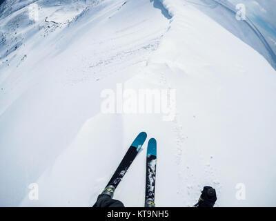 skier freerider on mountain peak ready for pure powder ride - Stock Photo