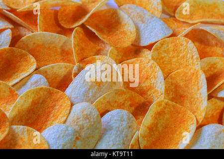 Close up potato chips wood top view background. - Stock Photo