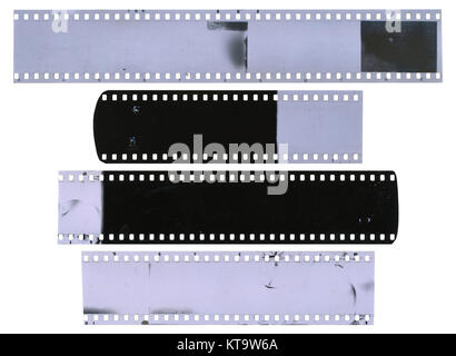 Old, used, dusty and scratched celluloid film strips - Stock Photo