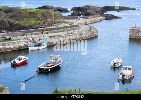 Boats in Ballintoy Harbour, County Antrim, Northern Ireland - Stock Photo
