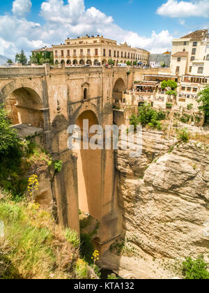 view of buildings over cliff in ronda, spain - Stock Photo
