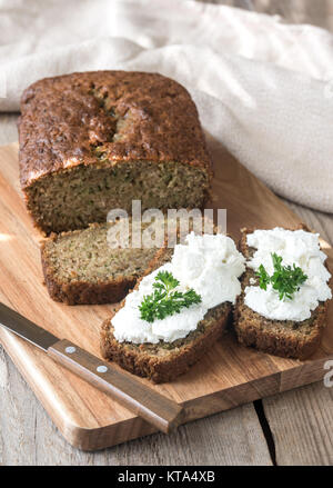 Zucchini bread on the wooden board - Stock Photo