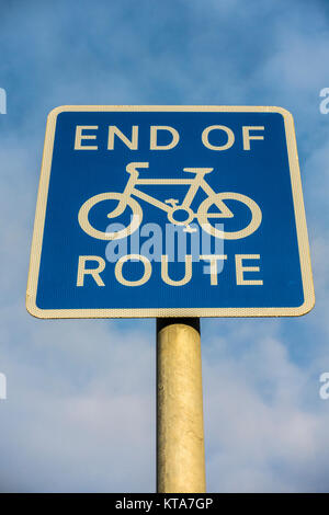End of cycle route, white on blue sign, in England, UK, used where bicycles can ride on part of a pavement or road, - Stock Photo