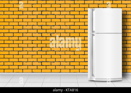 Major appliance - Refrigerator in front on a yellow brick wall background - Stock Photo