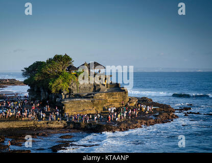 pura tanah lot famous balinese temple landmark on bali island coast indonesia at sunset - Stock Photo
