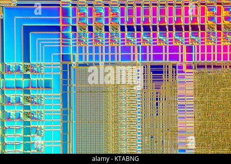 Light micrograph of a detail of a RAM computer memory chip. RAM is a type of computer memory that can be accessed - Stock Photo