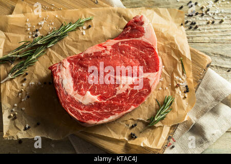 Raw Grass Fed Boneless Ribeye Steak Ready to Cook - Stock Photo