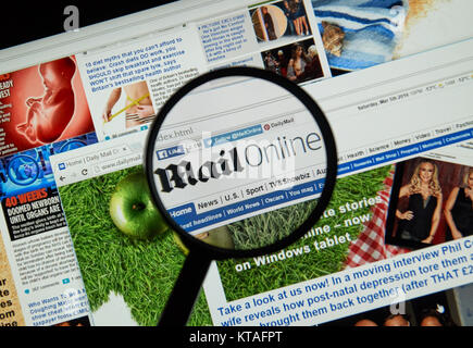 MONTREAL, CANADA - MARCH 20, 2016 - MailOnline web page under magnifying glass. MailOnline is the website of the - Stock Photo