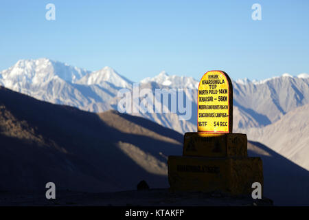 The sign on the top of Kardung La pass - claimed as the highest motorable pass in the world (5.359 m), Ladakh, Jammu - Stock Photo