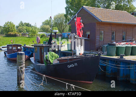 Fishing cutter at fishermans house, harbour of Gager, Moenchgut, Ruegen island, Mecklenburg-Western Pomerania, Baltic - Stock Photo