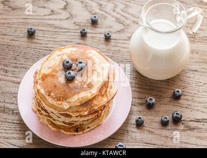 Pancakes with maple syrup and fresh blueberries - Stock Photo