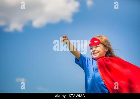 Funny little girl playing power super hero. - Stock Photo