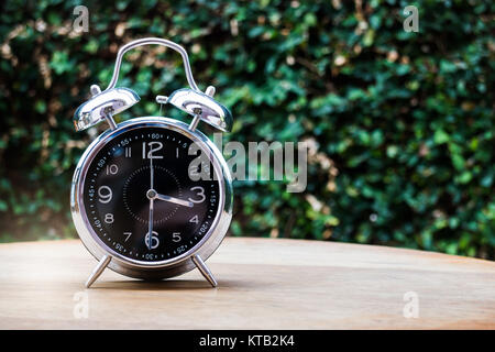 Alarm Clock On Wooden Background - Stock Photo