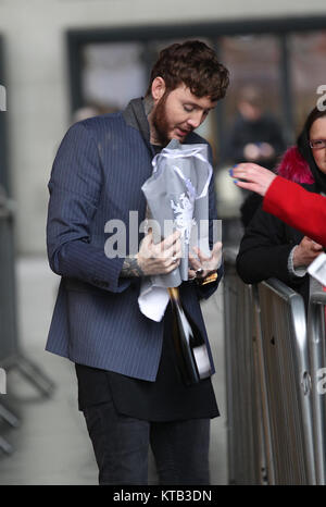 London, UK. 21st December, 2017. James Arthur British singer-songwriter seen receiving gifts from fans at the BBC - Stock Photo