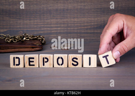 deposit. Wooden letters on dark background. Office desk - Stock Photo