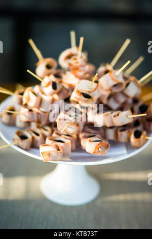 Delicious canapes on the white plate. close-up. - Stock Photo