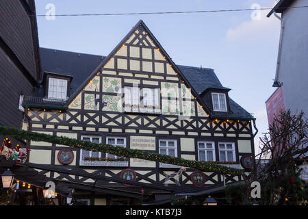 The Restaurant Stadt Frankfurt is decorated with lights for Christmas. The 24th RŸdesheim Christmas Market of Nations - Stock Photo