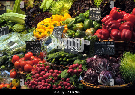 a brightly coloured display of vegetables  on sale on a stall at borough market in London. Various fruits and vegetables - Stock Photo