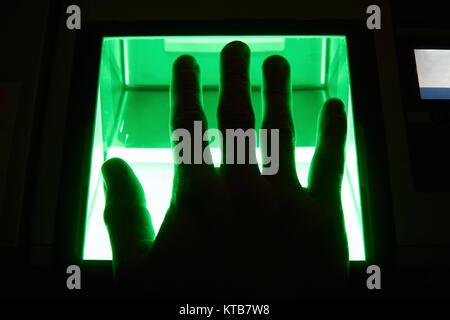 green cybersecurity digital fingerprint scanning on a green screen - Stock Photo