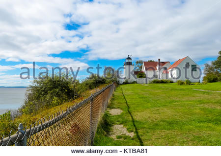 Lighthouse by the Fence - Stock Photo
