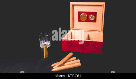 Cigar box on black background and lighter - Stock Photo