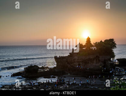 pura Goa Lawah hindu temple sunset backlight silhouette in bali indonesia - Stock Photo