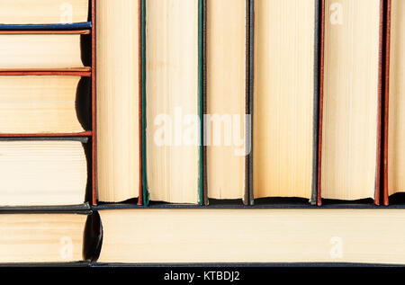 Abstract background of stacked on each other old books - Stock Photo