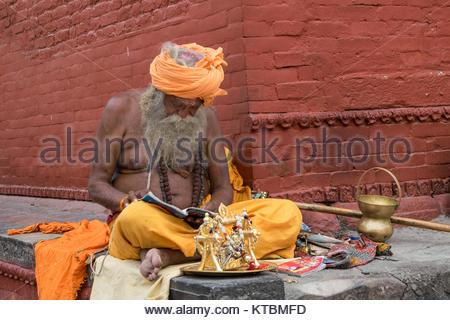 KATHMANDU, NEPAL MAY 15, 2017: Portrait of holy man Sadhu hindu people in a hindu temple. - Stock Photo