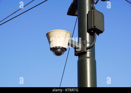 Hi-tech dome type camera and a blue sky . - Stock Photo
