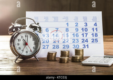 Tax Time On Alarm Clock With Coins - Stock Photo