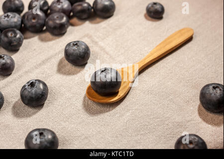 big blueberry in wooden spoon - Stock Photo