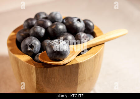 big blueberry in wooden bowl - Stock Photo